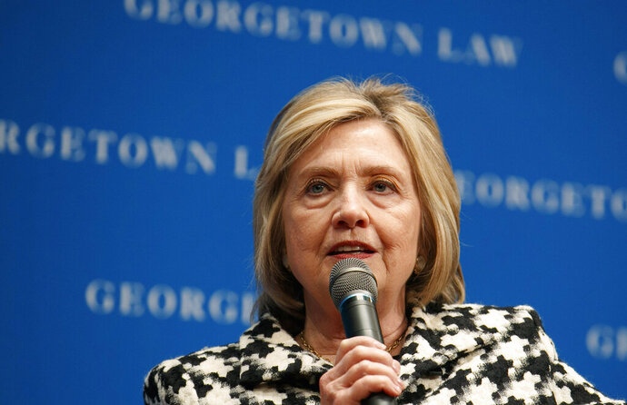 "FILE - In this file photo dated Wednesday, Oct. 30, 2019, former U.S. Secretary of State Hillary Clinton speaks at Georgetown Law's second annual Ruth Bader Ginsburg Lecture, in Washington.  Clinton told the BBC on Tuesday Nov. 12, 2019, that she's ""dumbfounded"" the U.K. government has failed to release a report on Russian influence in British politics as the country prepares for national elections on Dec 12.  (AP Photo/Jacquelyn Martin, FILE)"