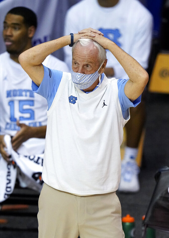 North Carolina head coach Roy Williams reacts as he watches team play in the second half of an NCAA college basketball game for the championship of the Maui Invitational, Wednesday, Dec. 2, 2020, in Asheville, N.C. Texas won 69-67. (AP Photo/Kathy Kmonicek)