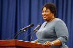 FILE - In this March 1, 2020, file photo, Stacey Abrams speaks at the unity breakfast in Selma, Ala. Many Black voters are skeptical of voting by mail even as states seek to expand that option during the coronavirus pandemic. In 2018, Abrams' campaign mailed 1.6 million absentee ballot requests to Georgia voters during her unsuccessful bid for governor. The campaign emphasized that it was a safe and easy way to vote. (AP Photo/Butch Dill, File)