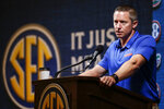 Florida head coach Mike White speaks during the Southeastern Conference NCAA college basketball media day, Wednesday, Oct. 16, 2019, in Birmingham, Ala. (AP Photo/Butch Dill)