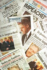 FILE - This is a photo montage showing the Sunday, Dec. 20, 1998 editions of newspapers from Massachusetts and Rhode Island with headlines of President Clinton's impeachment. The newpapers shown are: The Patriot Ledger, The Sun, Cape Cod Times, Boston Herald, The Boston Globe, The Metrowest Daily News, Sunday Republican, The Providence Journal and Sunday Telegram. (AP Photo/Peter Lennihan)