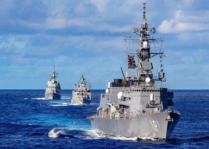 In this photo released by Defense Visual Information Distribution Service, ships from Japan Maritime Self-Defense Force and Indian Navy sail in formation with Royal Australian Navy HMAS Warramunga and Arleigh Burke-class guided-missile destroyer USS Barry (DDG 52) during MALABAR 2021 on Aug. 27, 2021. China seeks to bring the strategically and symbolically important island back under its control, and the U.S. sees Taiwan in the context of broader challenges from China. (Justin Stack/DVIDS U.S. Navy via AP)