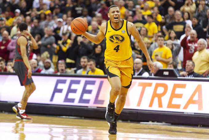 Missouri's Javon Pickett celebrates after getting fouled in the final minute of their 83-79 overtime victory over Arkansas in an NCAA college basketball game Saturday, Feb. 8, 2020, in Columbia, Mo.. (AP Photo/L.G. Patterson)