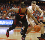 Louisville's Khwan Fore, left, and Syracuse's Buddy Boeheim, right, dive for a loose ball during the second half of an NCAA college basketball in Syracuse, N.Y., Wednesday, Feb. 20, 2019. Syracuse won 69-49. (AP Photo/Nick Lisi)