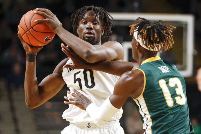 Vanderbilt forward Ejike Obinna (50) protects the ball from Southeastern Louisiana forward Pape Diop (13) in the first half of an NCAA college basketball game Monday, Nov. 25, 2019, in Nashville, Tenn. (AP Photo/Mark Humphrey)