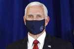 Vice President Pence wears a mask as he is introduced to speak to the Commissioned Corps of the U.S. Public Health Service at their headquarters in Rockville, Md., June 30, 2020. As the public face of the administration's coronavirus response. Vice President Mike Pence has been trying to convince Americans that the country is winning even as cases spike in large parts of the country. For public health experts, that sense of optimism is detached from reality. (AP Photo/Jacquelyn Martin)