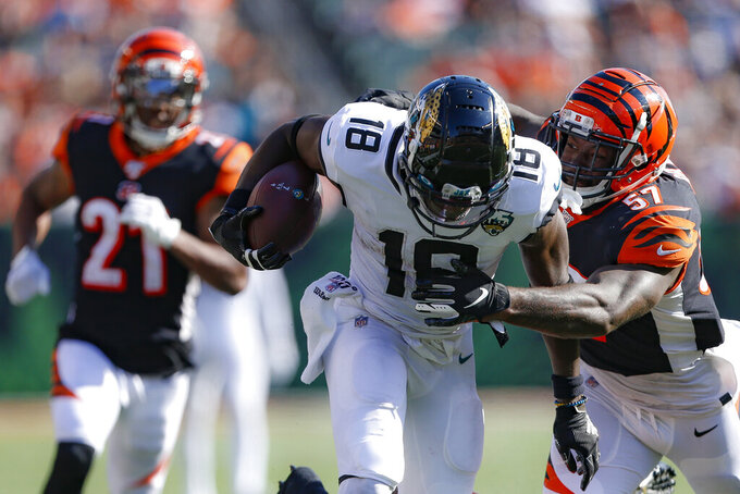 Jacksonville Jaguars wide receiver Chris Conley (18) runs the ball against Cincinnati Bengals linebacker Germaine Pratt (57) in the second half of an NFL football game, Sunday, Oct. 20, 2019, in Cincinnati. (AP Photo/Gary Landers)