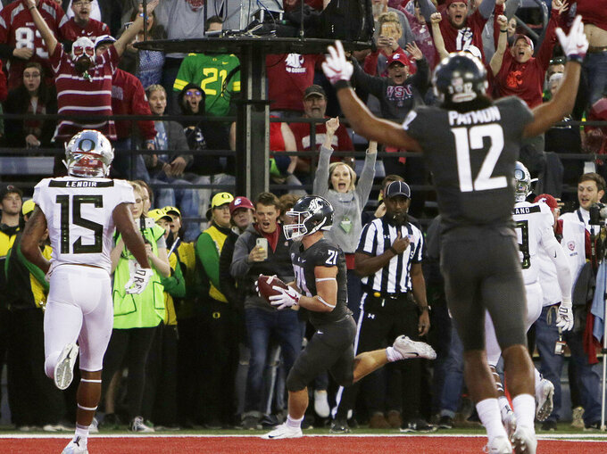 Washington State running back Max Borghi (21) runs for a touchdown during the first half of an NCAA college football game against Oregon in Pullman, Wash., Saturday, Oct. 20, 2018. (AP Photo/Young Kwak)