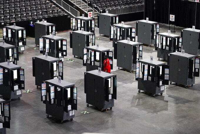 A man tries to vote early but can't because the machines stopped working during early voting at the State Farm Arena on Monday, Oct. 12, 2020, in Atlanta. (AP Photo/Brynn Anderson)