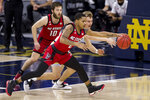 North Carolina State's Shakeel Moore (2) steals the ball Notre Dame's Dane Goodwin during the first half of an NCAA college basketball game Wednesday, March 3, 2021, in South Bend, Ind. (AP Photo/Robert Franklin)