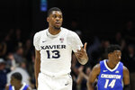 Xavier's Naji Marshall reacts after scoring during the first half of the team's NCAA college basketball game against Creighton, Wednesday, Feb. 13, 2019, in Cincinnati. (AP Photo/John Minchillo)