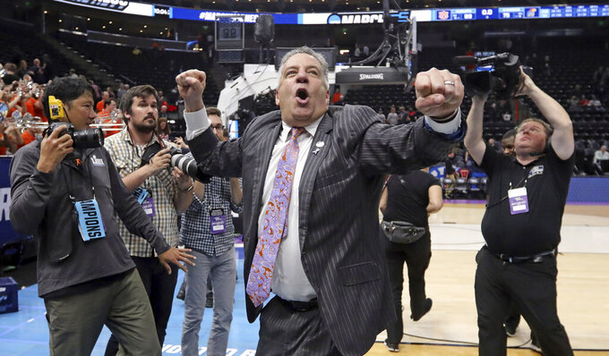 Auburn coach Bruce Pearl shouts to Auburn fans following the team's victory over Kansas in a second-round game in the NCAA men's college basketball tournament Saturday, March 23, 2019, in Salt Lake City. (AP Photo/Rick Bowmer)