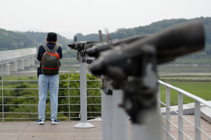A visitor watches the northern side from the Imjingak Pavilion in Paju, South Korea, Thursday, June 18, 2020. Relations between the Koreas have been strained since a second Kim-Trump summit in early 2019 fell apart due to wrangling over the sanctions. (AP Photo/Lee Jin-man)