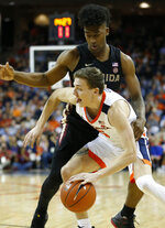 Virginia guard Kyle Guy (5) drives past Florida State guard Florida State guard Terance Mann (14) during the first half of an NCAA college basketball game in Charlottesville, Va., Saturday, Jan. 5, 2019. (AP Photo/Steve Helber)