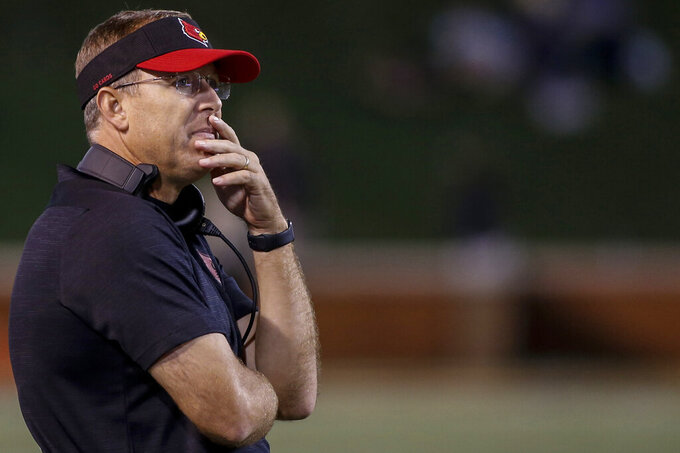 FILE - In this Oct. 12, 2019, file photo, Louisville coach Scott Satterfield watches his team play Wake Forest during the second half of an NCAA college football game, in Winston-Salem, N.C. Satterfield was selected as The Associated Press All-Atlantic Coast Conference football team Coach of the Year, Tuesday, Dec. 10, 2019. (AP Photo/Nell Redmond, File)
