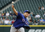Texas Rangers starting pitcher Bartolo Colon throws against the Seattle Mariners during the first inning of a baseball game, Wednesday, May 16, 2018, in Seattle. (AP Photo/Ted S. Warren)