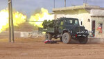 FILE -- In this Saturday, Jan. 20, 2018 file photo, provided by the government-controlled Syrian Central Military Media, shows Syrian government forces firing their weapon during a battle against the Syrian opposition fighters, in the southern Aleppo countryside, Syria. In two months of intensive airstrikes and bombardments on the rebel-controlled province of Idlib, Syrian government forces and their Russian allies have failed to make progress against battle-hardened insurgents. (Syrian Central Military Media, via AP, File)