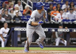 Los Angeles Dodgers' Corey Seager leaves the batter's box after hitting a two-run home run during the first inning of the team's baseball game against the Miami Marlins, Wednesday, Aug. 14, 2019, in Miami. (AP Photo/Lynne Sladky)