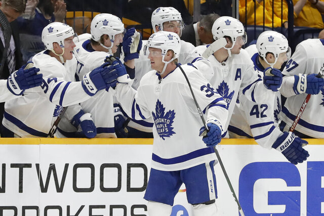 Toronto Maple Leafs defenseman Rasmus Sandin (38), of Sweden, is congratulated after scoring a goal against the Nashville Predators in the second period of an NHL hockey game Monday, Jan. 27, 2020, in Nashville, Tenn. (AP Photo/Mark Humphrey)