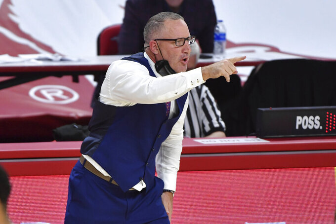Texas A&M coach Buzz Williams talks to his team from the sideline as they play against Arkansas during the second half of an NCAA college basketball game in Fayetteville, Ark., Saturday, March 6, 2021. (AP Photo/Michael Woods)