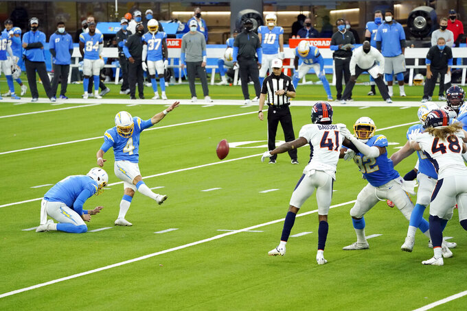 Los Angeles Chargers kicker Mike Badgley (4) kicks the game-winning field goal during the fourth quarter of an NFL football game against the Denver Broncos Sunday, Dec. 27, 2020, in Inglewood, Calif. (AP Photo/Ashley Landis)