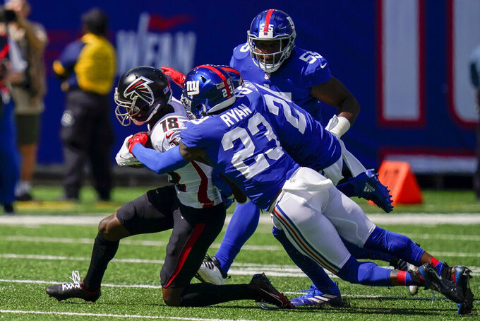 Atlanta Falcons wide receiver Calvin Ridley (18) is tackled by New York Giants cornerback Logan Ryan (23) during the first half of an NFL football game, Sunday, Sept. 26, 2021, in East Rutherford, N.J. (AP Photo/Seth Wenig)