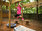 """Joey Ray uses apparatus to work out in his family's Spotsylvania County, Va., backyard on Tuesday, Aug. 31, 2021. Ray was selected to compete on the TV show """"American Ninja Warrior Junior."""" His episode will air Sept. 16 on Peacock. (Peter Cihelka/The Free Lance-Star via AP)"""