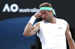 Tennys Sandgren of the U.S. reacts after winning a point against compatriot Sam Querrey during their third round singles match at the Australian Open tennis championship in Melbourne, Australia, Friday, Jan. 24, 2020. (AP Photo/Dita Alangkara)