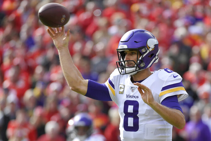 Minnesota Vikings quarterback Kirk Cousins (8) throws during the first half of an NFL football game against the Kansas City Chiefs in Kansas City, Mo., Sunday, Nov. 3, 2019. (AP Photo/Reed Hoffmann)