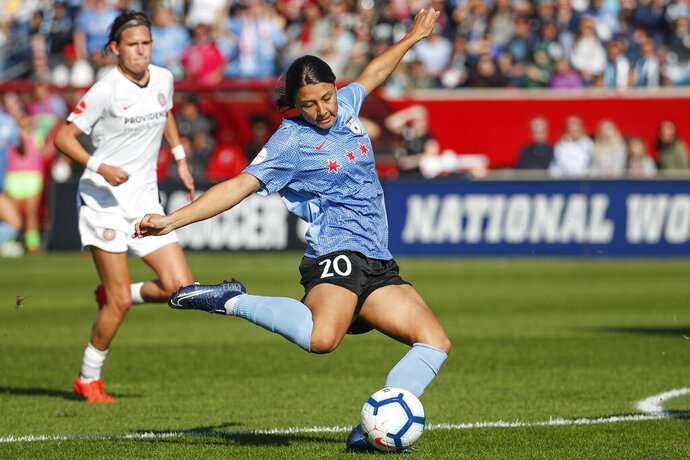Chicago Red Stars forward Sam Kerr scores against the Portland Thorns FC during the first half of an NWSL playoffs semi-final soccer match Sunday, Oct. 20, 2019, in Bridgeview, Ill. (AP Photo/Kamil Krzaczynski)