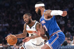 Denver Nuggets guard Will Barton (5) drives to the basket as New York Knicks center Mitchell Robinson (13) defends during the first half of an NBA basketball game Thursday, Dec. 5, 2019, at Madison Square Garden in New York. (AP Photo/Mary Altaffer)