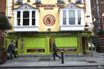 A closed bar in Dublin, Ireland, Wednesday, Oct. 21, 2020. With COVID-19 cases on the rise, the government has imposed a tough new lockdown, shutting down non-essential shops, limiting restaurants to takeout service and ordering people to stay within five kilometers (three miles) of their homes for the next six weeks. (AP Photo/Peter Morrison)