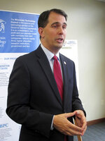 FILE - In this June 6, 2018, file photo, then Wisconsin Gov. Scott Walker speaks at a news conference in Madison, Wis. Wisconsin's conservative-controlled Supreme Court on Friday, June 21, 2019, upheld lame-duck laws limiting the powers of Democratic Gov. Evers and Attorney General Josh Kaul, handing Republican lawmakers a resounding victory. (AP Photo/Scott Bauer, File)