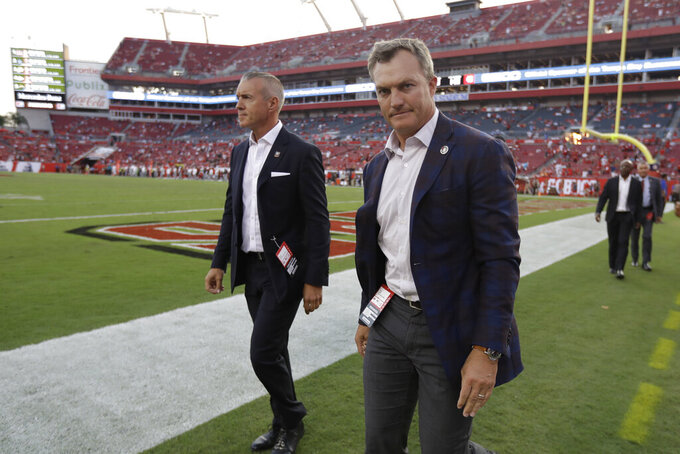 San Francisco 49ers General Manager John Lynch, right, walks the field during the second half an NFL football game, Sunday, Sept. 8, 2019, in Tampa, Fla. The San Francisco 49ers won 31-17. (AP Photo/Chris O'Meara)