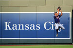 Minnesota Twins center fielder Byron Buxton catches a fly ball hit by Kansas City Royals' Adalberto Mondesi during the third inning of a baseball game at Kauffman Stadium in Kansas City, Mo., Saturday, Aug. 8, 2020. (AP Photo/Orlin Wagner)