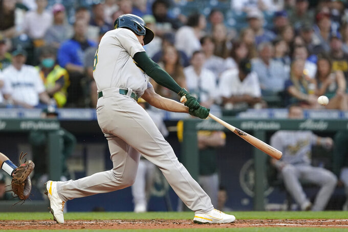 Oakland Athletics' Matt Olson hits a solo home run during the fourth inning of the team's baseball game against the Seattle Mariners, Friday, July 23, 2021, in Seattle. (AP Photo/Ted S. Warren)