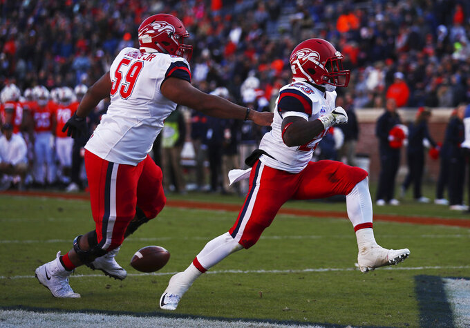 Liberty running back Frankie Hickson (23) celebrates with offensive lineman Damian Bounds (59) in the first half of an NCAA college football game against Virginia  Saturday, Nov. 10, 2018, in Charlottesville, Va. (Zack Wajsgras /The Daily Progress via AP)