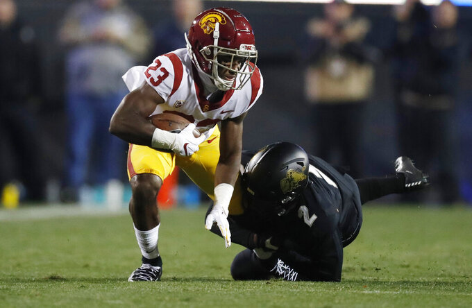 Southern California running back Kenan Christon, left, is tackled by Colorado safety Mikial Onu after catching a pass for a short gain during the first half of an NCAA college football game Friday, Oct. 25, 2019, in Boulder, Colo. (AP Photo/David Zalubowski)