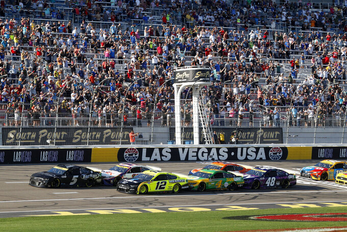 Drivers get the green flag at the start of a NASCAR Cup Series auto race at Las Vegas Motor Speedway, Sunday, Sept. 26, 2021, in Las Vegas. (AP Photo/Steve Marcus)