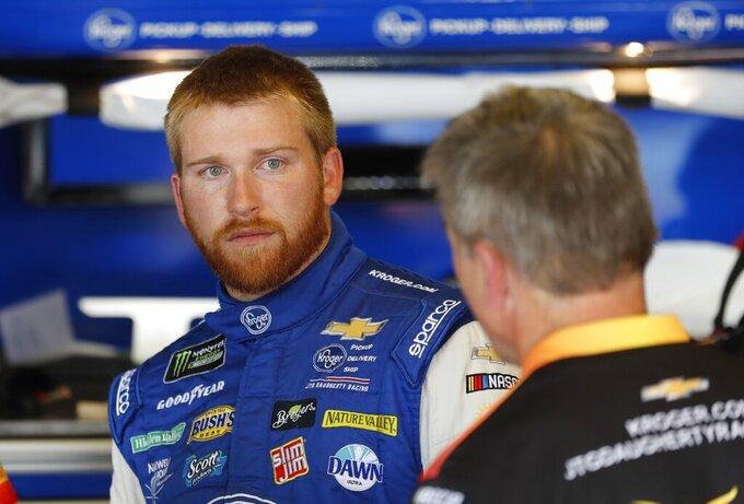 FILE - In this June 7, 2019, file photo, Chris Buescher talks to his crew after a practice session for a NASCAR Cup series race at Michigan International Speedway, in Brooklyn, Mich. Ricky Stenhouse Jr. and Roush Fenway Racing will split at the end of the season and Chris Buescher will replace him in 2020. Although his contract is believed to run through 2021, the team said Wednesday, Sept. 25, 2019, it will part ways with the two-time Xfinity Series champion at the end of the year. (AP Photo/Carlos Osorio, File)