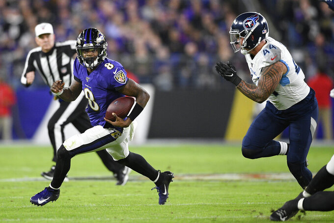 Tennessee Titans outside linebacker Kamalei Correa (44) chases Baltimore Ravens quarterback Lamar Jackson (8) during the first half an NFL divisional playoff football game, Saturday, Jan. 11, 2020, in Baltimore. (AP Photo/Nick Wass)