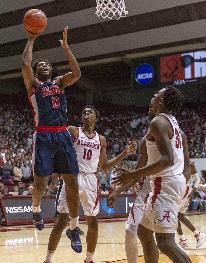 Mississippi guard/forward Blake Hinson (0) gets by Alabama guard Herbert Jones (10) for a shot during the first half of an NCAA college basketball game, Tuesday, Jan. 22, 2019, in Tuscaloosa, Ala. (AP Photo/Vasha Hunt)