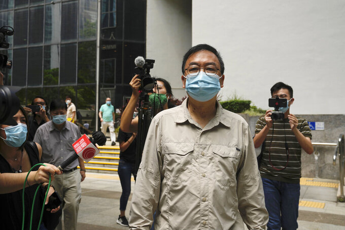 Pro-democracy activist Cheung Man-kwong walks out of a court after receiving a suspended sentence in Hong Kong, Wednesday, Sept. 15, 2021. Nine Hong Kong activists and ex-lawmakers were handed jail sentences of up to 10 months, and three others including Cheung were given suspended sentences on Wednesday over their roles in last year's banned Tiananmen candlelight vigil, the latest blow in an ongoing crackdown on dissent in Hong Kong. (AP Photo/Kin Cheung)