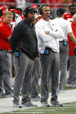 FILE - In this Sept. 22, 2018, file photo, Ohio State head coach Urban Meyer, right, and offensive coordinator Ryan Day watch from the sidelines against Tulane during the second half of an NCAA college football game, in Columbus, Ohio. Ohio State says Urban Meyer will retire after the Rose Bowl and assistant Ryan Day will be the next head coach. After seven years and a national championship at Ohio State, the 54-year-old Meyer will formally announce his departure Tuesday, Dec. 4, 2018, at a news conference. (AP Photo/Jay LaPrete, File)