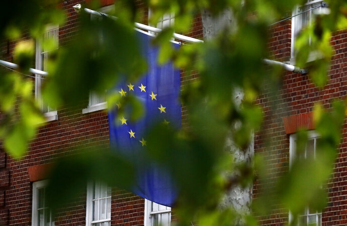 The EU flag hangs from Europa House in London, Tuesday, Sept. 29, 2020. The ninth round of trade talks between the EU and Britain is set to start in Brussels as the two sides continue to clash over the controversial UK Internal Market Bill. (AP Photo/Frank Augstein)