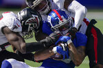New York Giants wide receiver Kenny Golladay (19) is tackled by Atlanta Falcons defensive back T.J. Green, right, during the second half of an NFL football game, Sunday, Sept. 26, 2021, in East Rutherford, N.J. (AP Photo/Seth Wenig)