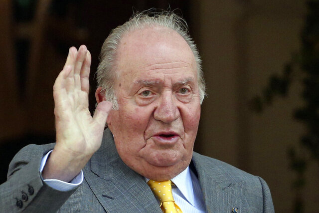 FILE - In this March 10, 2018 file photo, Spain's former monarch King Juan Carlos waves upon his arrival to the Academia Diplomatica de Chile, in Santiago. The Spanish parliament's decision-making board has rejected two proposals calling for the lower chamber to investigate whether former King Juan Carlos received millions of dollars in kick-back payments from Saudi Arabia. The proposals voted Tuesday March 10, 2020 were triggered by an ongoing investigation by Swiss prosecutors into an account reportedly operated for the Spanish monarch, including an alleged payment of 88 million euros (100 million dollars) by late Saudi King Abdullah in 2008. (AP Photo/Esteban Felix, File)