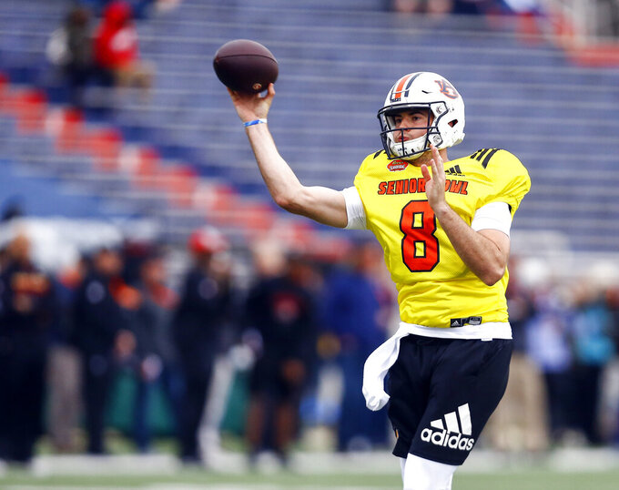South quarterback Jarrett Stidham of Auburn (8) throws a pass during practice for Saturday's Senior Bowl college football game, Tuesday, Jan. 22, 2019, in Mobile, Ala. (AP Photo/Butch Dill)