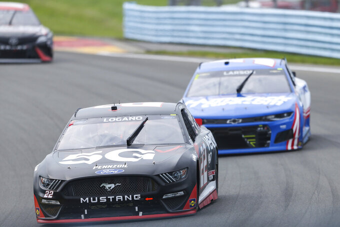 Joey Logano (22) leads Kyle Larson (5) as they drive up the esses during a NASCAR Cup Series auto race in Watkins Glen, N.Y., on Sunday, Aug. 8, 2021. (AP Photo/Joshua Bessex)