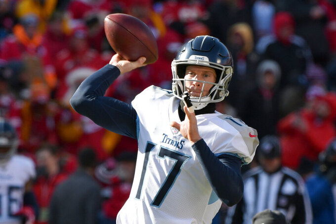 Tennessee Titans' Ryan Tannehill warms up before the NFL AFC Championship football game against the Kansas City Chiefs Sunday, Jan. 19, 2020, in Kansas City, MO. (AP Photo/Ed Zurga)